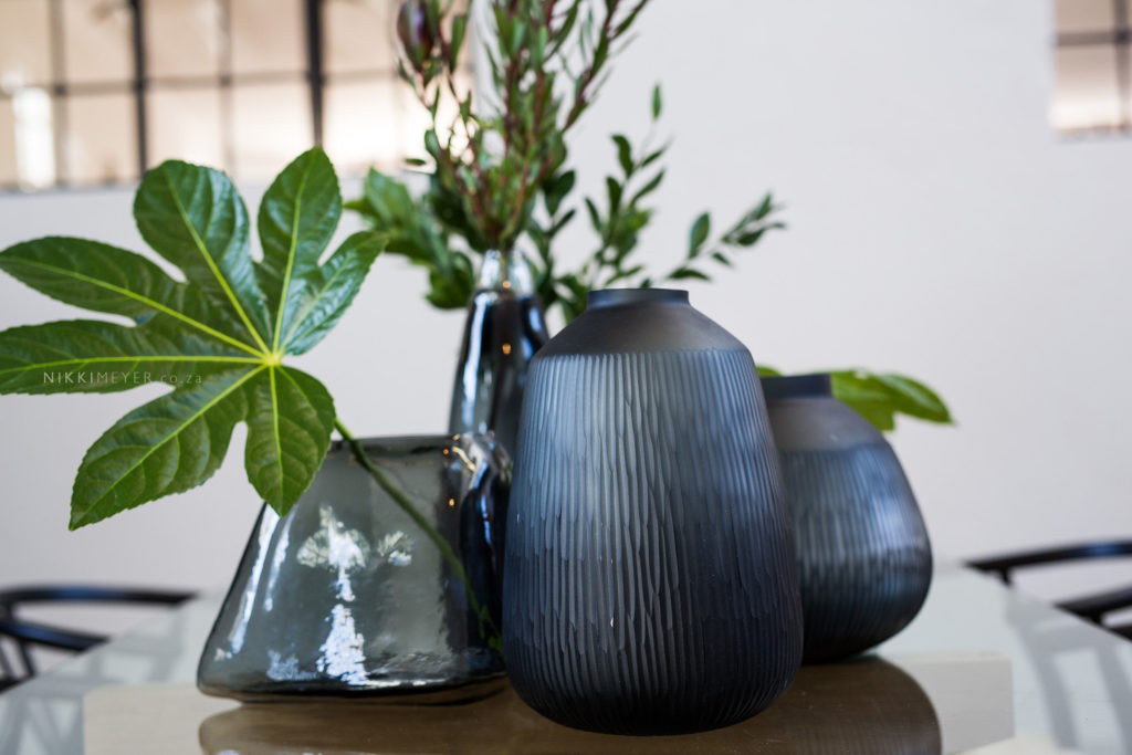 You can't go wrong with added greenery or large vases.